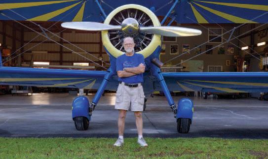 Clark Dechant standing in front of a plane