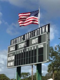 Historic Dodgertown baseball scoreboard with an American Flag over it.