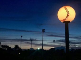A large baseball streetlight at night