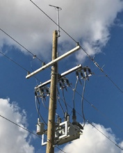 Power pole with electrical equipment attached