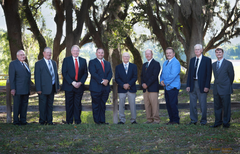 Photo of SVEC board standing outside with a fence and trees in the background