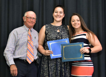 Girl with diploma and her parents