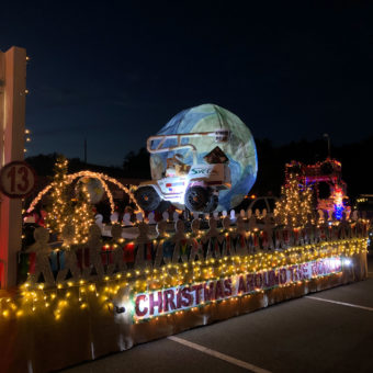 float with colorful lights at the Christmas parade