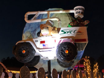Stuffed bear in small SVEC bucket truck at the Christmas parade