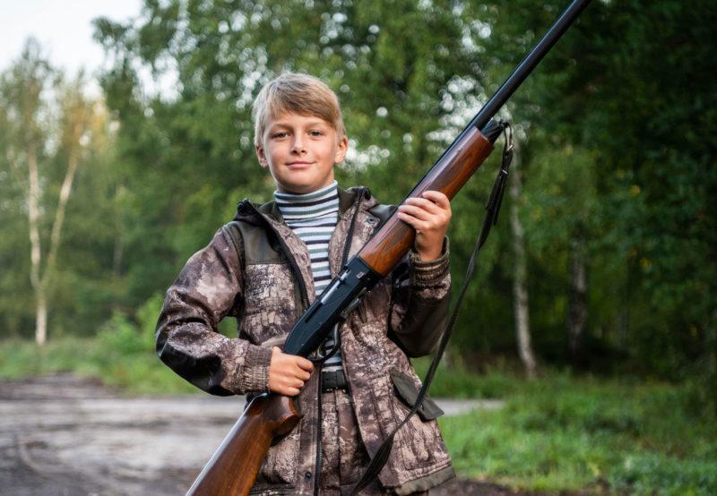 kid with shotgun