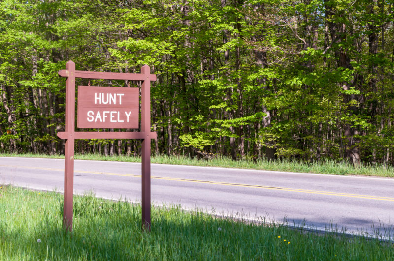 Hunt Safely sign on the side of a road