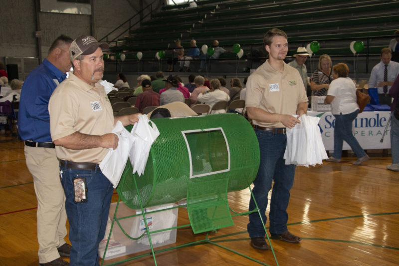 Employees Danny and Braxton operate an activity during the annual meeting