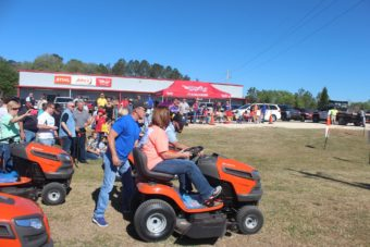 people at the lawn mower race
