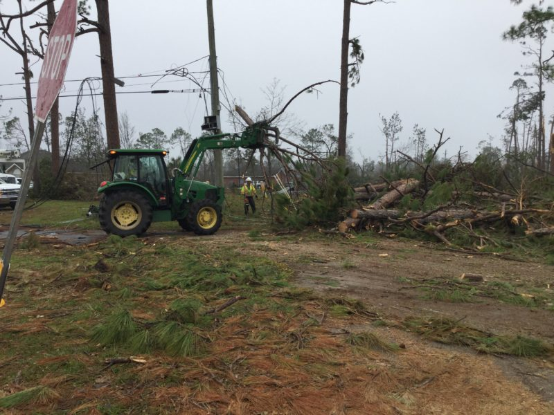 Tractor clearing storm debris