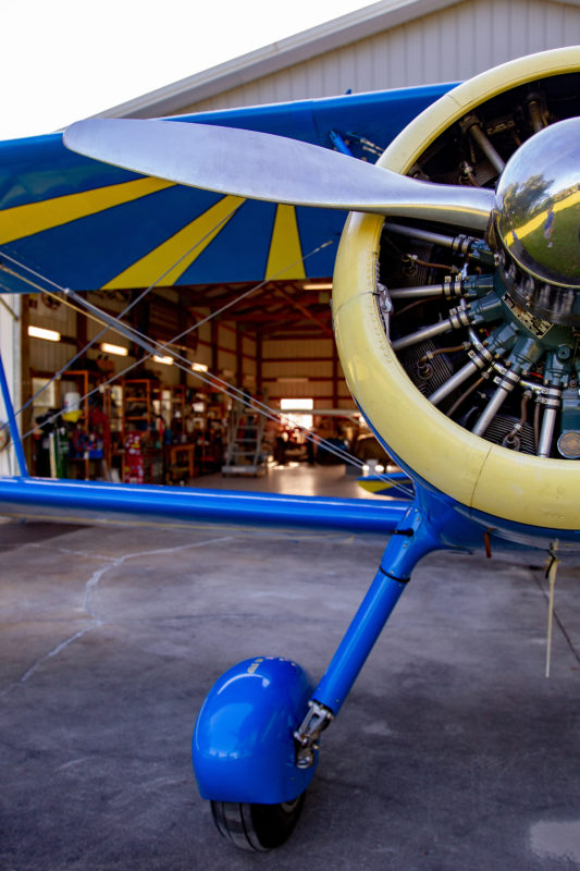 front of small blue plane