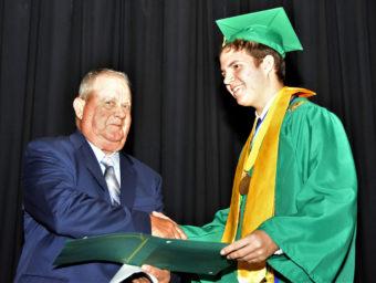 Young man receiving diploma