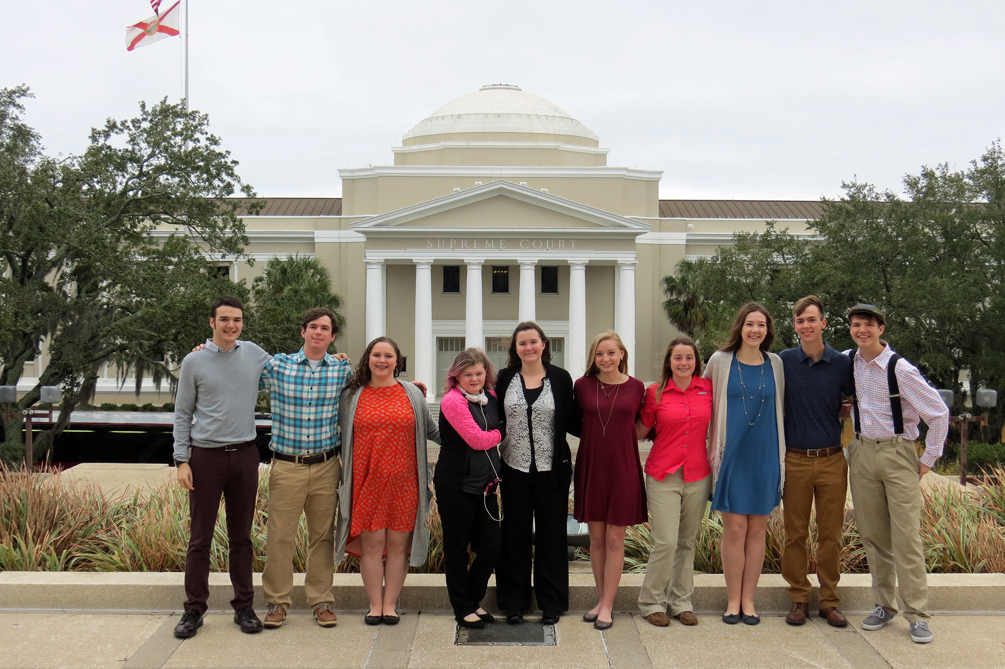 students with supreme court in front of building