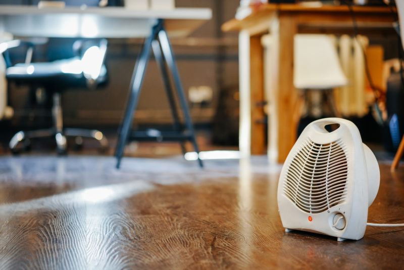 Space heater sitting on floor of room