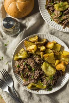 pot roast on a plate with potatoes