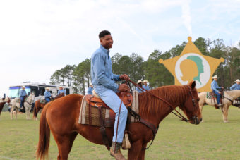 teenager riding a horse outside