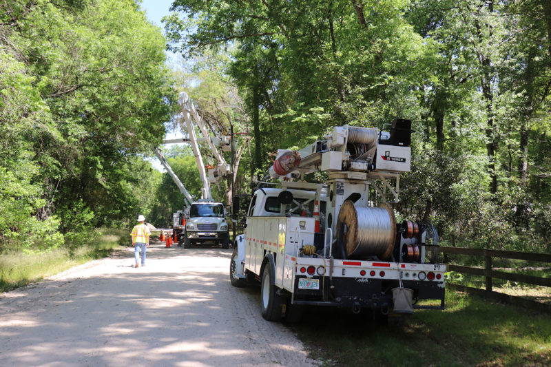 bucket trucks on road