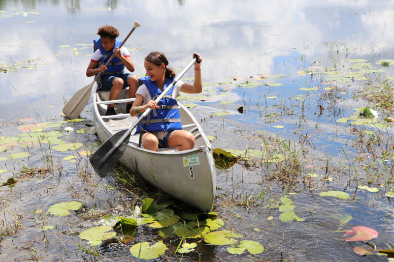 kids in canoe on lake
