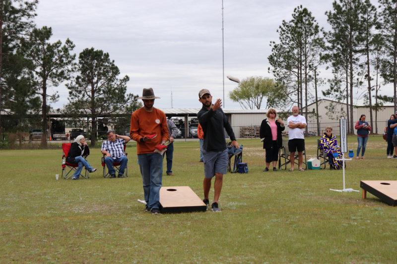 a team playing cornhole tournament