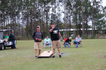 two teams playing in cornhole tournament