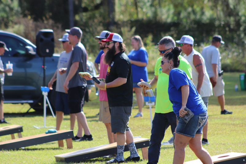 group of people playing at cornhole tournament