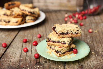 cranberry crumble bars on plate on table