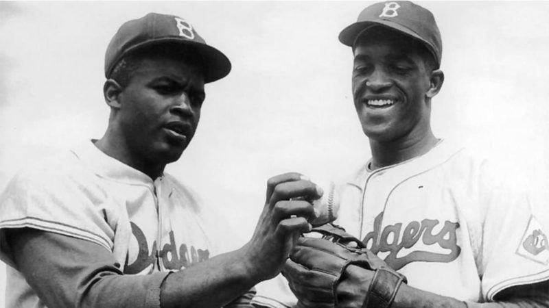 Jackie Robinson with another baseball player in uniform