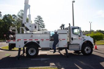 lineman going onto bucket truck