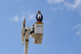 lineman about to drop egg from bucket truck