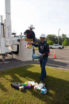 lineman bringing up egg projects to bucket truck