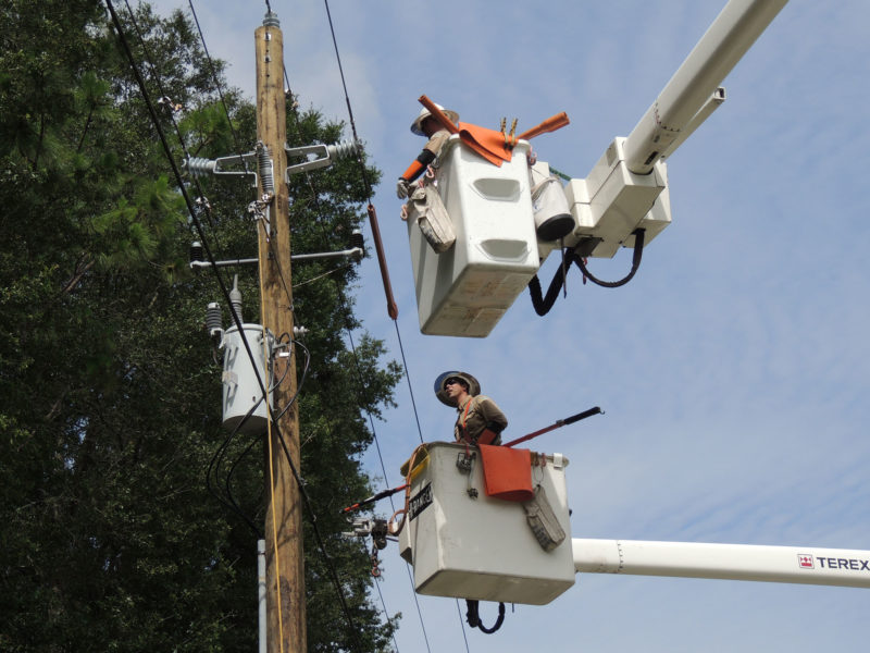 linemen working on power poles