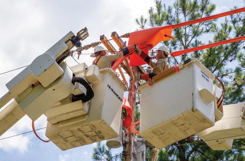 Linemen working on power pole
