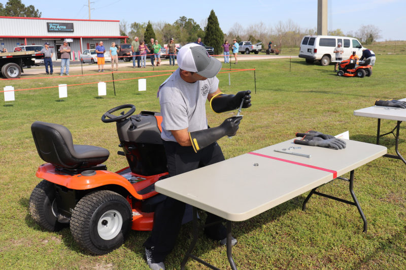 Man at pit stop at lawn mower race