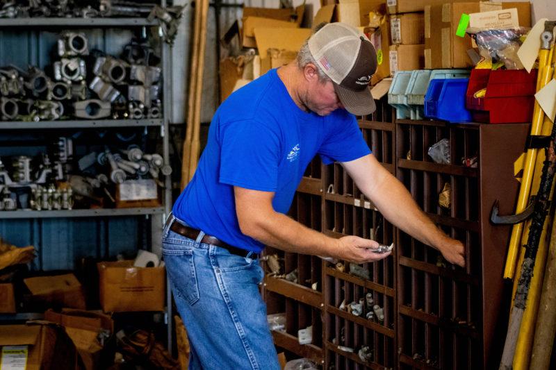 man looking through tools at warehouse