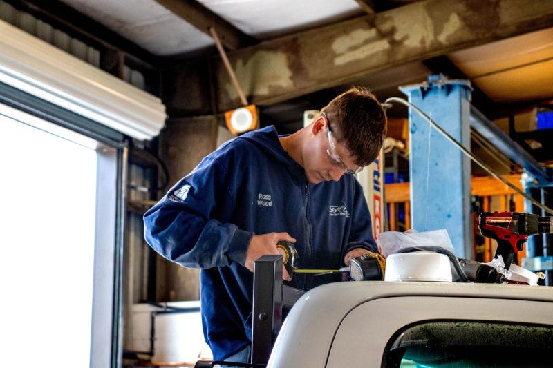 Mechanic Ross Wood working on vehicle