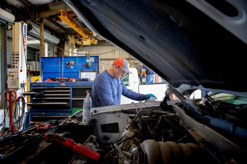 Raymond Poole working on vehicle