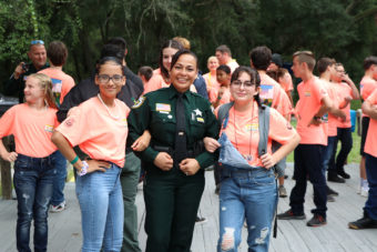 group of kids posing with sheriff